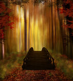 Enchanted forest with bridge. Fantastic forest with a wooden bridge in autumn royalty free stock photo