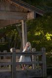 Enchanted garden. Little girl near water in garden Stock Photography