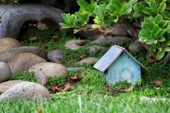 Enchanted Garden. A magical little fairy house in an enchanted garden Royalty Free Stock Photos