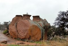 Enchanted Rock State Natural Area in rainy and foggy day stock images