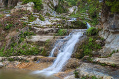 Enchanted small waterfall Stock Images