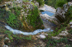 Enchanted small waterfall Stock Photo