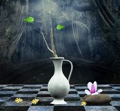 Enchanted still life. A wonderful still life composition with vase, branch, stones, leaves and magnolia flower inspired by an old picture Stock Photo