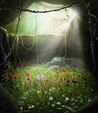 Enchanting Fairy Cave Filled with Flowers. 3D render illustration of an enchanting fairy tale cave filled with flowers in a magical forest Royalty Free Stock Images