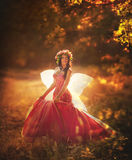 Enchanting Nymph in forest Stock Photos