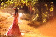 Enchanting Nymph in forest. Stock Image royalty free stock photo