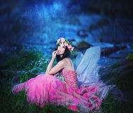 Enchanting Nymph in forest Stock Images
