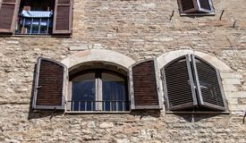 The Enchanting Streets of Asssi. Shuttered windows along the enchanting streets of Assisi, Italy royalty free stock image