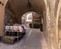 The Enchanting Streets of Asssi. A small restaurant along the enchanting streets of Assisi, Italy stock image