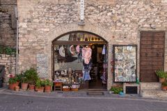 The Enchanting Streets of Asssi. A small shop along the enchanting streets of Assisi, Italy stock photo