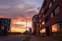 Enchanting sunset with bright colors and modern buildings in Klaipeda Street, Lithuania. Enchanting sunset with bright colors and modern buildings in Klaipeda royalty free stock image