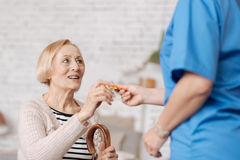 Enchanting trained doctor handing her patient the pills Royalty Free Stock Photos