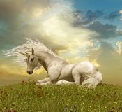 Enchanting White Unicorn Resting During a Sunset. 3D illustration of an enchanting white unicorn resting on a hill during a sunset Royalty Free Stock Photo