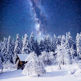 Enchanting winter tale. starry sky in a fantastic New Year's Eve Stock Photo