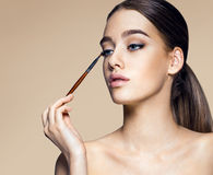 Enchanting young girl with brush for eyeshadow Stock Photography