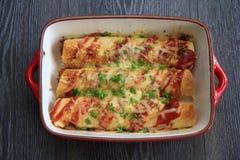 Enchiladas de poulet et de chorizo Photographie stock libre de droits