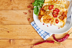 Enchiladas dish with red hot chili top view Stock Images