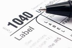Enchimento no formulário de imposto 1040 Imagens de Stock Royalty Free