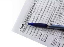 Enchimento no formulário de imposto 1040 Fotos de Stock