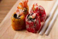 Enchimentos do sushi das ovas do caranguejo Imagem de Stock