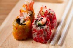 Enchimentos do sushi das ovas do caranguejo Foto de Stock Royalty Free