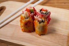 Enchimentos do sushi das ovas do caranguejo Foto de Stock