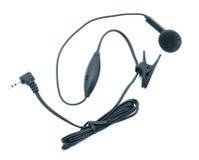 Enchufe de oído del teléfono celular Fotografía de archivo libre de regalías