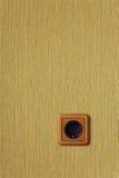 Enchufe de pared de madera Foto de archivo