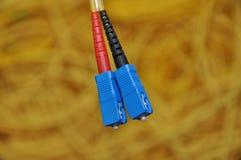 Enchufe del cable óptico Imágenes de archivo libres de regalías