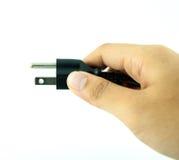 Enchufe eléctrico con la mano - enchufe Fotos de archivo libres de regalías