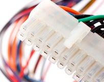 Enchufe eléctrico con los cables coloridos Fotos de archivo libres de regalías