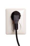 Enchufe eléctrico con el enchufe Foto de archivo