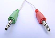 Enchufes audios verdes rojos   Fotos de archivo