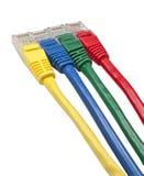 Enchufes coloreados brillantemente multi de la red de Ethernet Foto de archivo libre de regalías