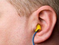 Enchufes de oído Imágenes de archivo libres de regalías