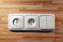 Enchufes e interruptores Imágenes de archivo libres de regalías