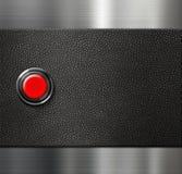 Encienda el botón en blanco rojo del motor en el cuero negro y fotografía de archivo