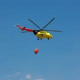 Encienda el helicóptero del rescate con el compartimiento de agua - cuadrado Fotos de archivo libres de regalías