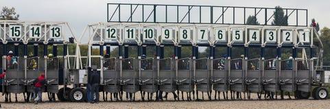 Encienda las puertas para las carreras de caballos Imagen de archivo libre de regalías