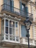 Enclosed balcony, Barcelona center, Spain. Enclosed balcony and candelabrum , Barcelona center, Spain Royalty Free Stock Photos