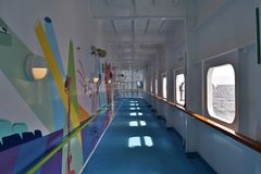 Enclosed Promenade. An enclosed promenade deck on a cruise ship royalty free stock image