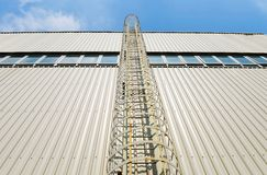 Enclosed safety ladder Stock Photography