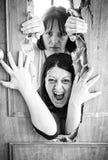 Enclosed women. Women locked door and aggressive Stock Photo