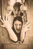 Enclosed women. Women locked door and aggressive Royalty Free Stock Photos