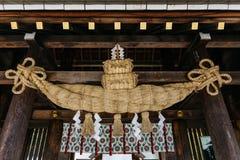 Enclosing Rope Shimenawa hanging on entrance gate ceiling of Hokkaido Shrine Hokkaido Jingu in winter in Sapporo. Hokkaido. Enclosing Rope Shimenawa hanging on Stock Images