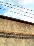Enclosure. Barbed-wire fence stock photos