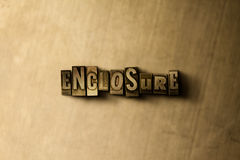 ENCLOSURE - close-up of grungy vintage typeset word on metal backdrop. Royalty free stock illustration.  Can be used for online banner ads and direct mail Stock Photography