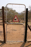 Enclosure gate. Fence gate to an encloser of a namibian game farm with an Oryx warning sign, Africa stock photo