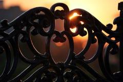 Enclosure and sun. Rise at city stock image