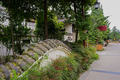 Enclosure in verdant plants. An old-fashioned enclosure beside the street in verdant green Stock Images